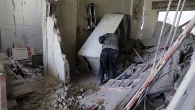 Syrian elder seeks memories in debris of E. Ghouta home