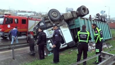 Ters dönen kamyonun altında kalan sürücü ağır yaralandı
