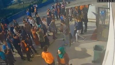 Hakkında soruşturma açılan öğretmenin, erkek öğrencisinin saçına toka taktığı anlar güvenlik kamerasında