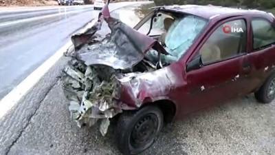 Yanan otomobildeki yaralılar son anda kurtarıldı