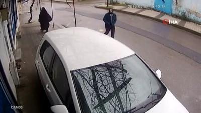 Camiden ayakkabı çalan hırsız kameraya yakalandı