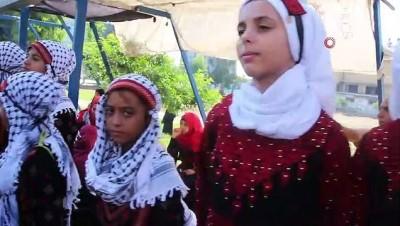 - Gazze'de Renkli Geleneksel Filistin Giysileri Günü