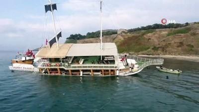 Sinop'ta karaya oturan tekne kurtarıldı...Tekne havadan görüntülendi