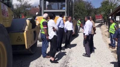 Vali Ümit iş makinesi kullanarak asfaltlama yaptı - BOLU