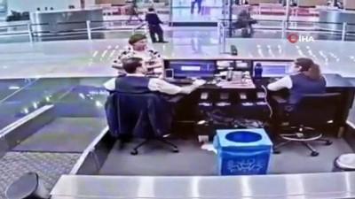 THY görevlisi, deprem sırasında yolcuyu böyle korudu