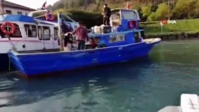 Hapis cezası bulunan zanlı, balıkçı teknesiyle kaçarken yakalandı