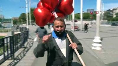 Balon satmak için sokağa çıkan 71 yaşındaki seyyar satıcı siftah yapamadan evine döndü