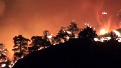 Manisa'da çıkan orman yangını kısmen kontrol altına alındı...Mahalleliler yangını çaresizlikle izledi