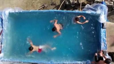 Çocuklarını tatile götüremeyen çiftçi baba traktör römorkunu havuza çevirdi - ANKARA