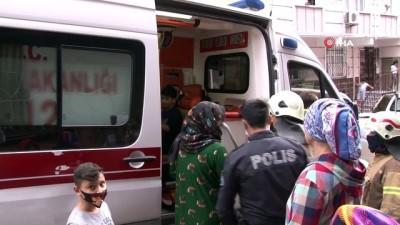 Binada çıkan yangında 1'i çocuk 2 kişi dumandan etkilendi