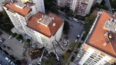 Vinçlerle tutulan apartmanda depremin verdiği hasar gün ağarınca ortaya çıktı