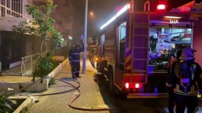 Depremde hasar gören binada yangın