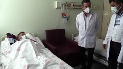 ANTALYA - Bir böbreğini kızına bağışlayan babanın 12 kilogramlık kitle oluşan diğer böbreği son anda kurtarıldı